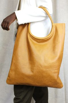 The most lovely classic boho leather bag in elegant mustard leather. Meet The Rosa, handcrafted by artisans and made with you top of mind. Comes with a coin purse and clips inside to add your keys or easily lost items. Shop Online!