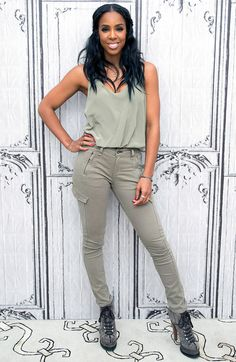 Kelly Rowland in a mint green top and skinny cargo pants