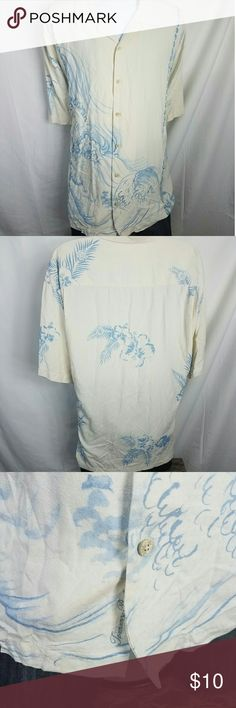 Tommy Bahama 100% Silk Hawiian Panel Shirt XXL 100% Silk shirt! Beautiful flower and waterscape design.   Small stain on the front of the shirt. please view all photos before purchase Chest Front: 27.5 inches Shoulder to Hem: 31 inches Tommy Bahama Shirts Casual Button Down Shirts