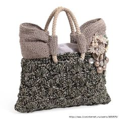 Unusual crochet hand bag design and materials.