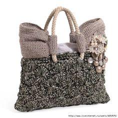 Unusual crochet hand bag design and materials.