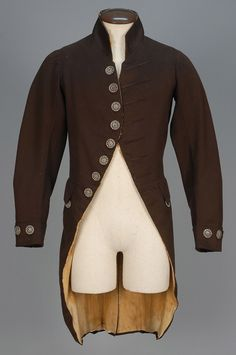 Early regency men's fashion 1800s ENGLISH WOOL LIVERY COAT, 1790 - 1800.Brown broadcloth cutaway having cut steel buttons, corded false buttonholes, button decorated shaped p...