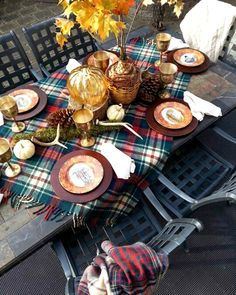 Decorated with pumpkins, pinecones, leaves, and antlers, this welcoming table is set for a rustic celebration.
