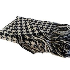 Cashmere and wool throw with a black and creme houndstooth motif. | $134.95