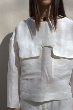 Contemporary Fashion - white shirt with large flap pocket detail // Nanushka