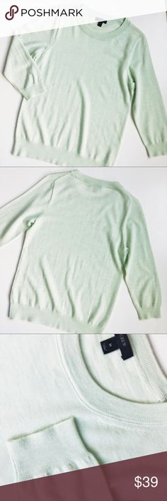 "J. Crew mint Tippi wool sweater Excellent condition with small spot on left sleeve (see picture) I haven't tried removing. 3/4 length sleeves, light weight and comfortable!  Details: •Size M •100% Merino wool •3/4 sleeves  Measurements: (approx) •Shoulders 14.5"" •Bust 17.5"" •Sleeve 19.5"" •Length 25.5"" J. Crew Tops"