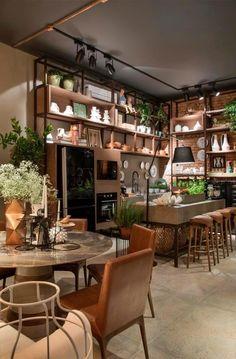 A Casa da Dinda é inspirada nos lofts nova-iorquinos. Paredes de tijolos aparentes, assoalho de cimento queimado e mobiliário marrom deixam o espaço, de 82 m², com toque rústico e aconchegante