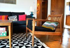 chair, pillows, rug
