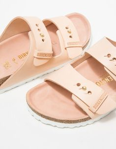 Two-strap, slip on sandal from Birkenstock with fully adjustable leather uppers, shock absorbing EVA sole, and original Birkenstock footbed.   • Two-strap slip on sandal • Fully adjustable leather straps • Original Birkenstock footbed • Narrow width