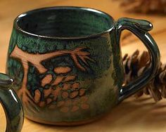 Google Image Result for http://www.wildwings.com/DirectionsWEB/client/images/handmade-green-pinecone-mug-8617639101.jpg