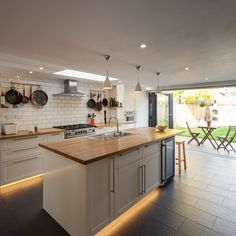 Galley Kitchen Ideas for a Transitional Kitchen with a White Pendants and Cleaveland Road by DBLO Associates Architects