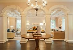 Dream foyer.  Ceiling, arches with molding and floors