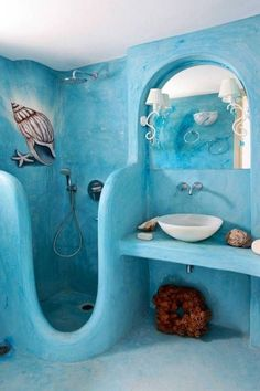 This enchanted nautical themed bathroom includes a unique shower enclosure and a pastel blue colour scheme.