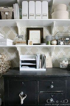 black dresser, white magazine files, shelves for office storage
