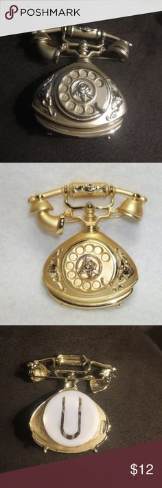 Ringing princess phone brooch This rotary telephone has a battery and actually rings. It rings when you press the button. It is gold tone and metal. It is vintage. vintage Jewelry Brooches