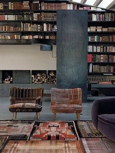 Industrial but cozy . The fabrics on the chairs and the rugs are wonderful and do a terrific job