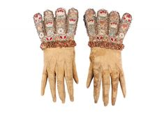 Gloves Worn by Charles I c 1625-1649. Cream/yellow leather, gloves. Whip- stitched seams, by hand using fine silk thread. The glove is attached to gauntlets consisting of eight rounded tabs covered with ivory silk satin, embroidered with flowers in coloured silks and gold metal thread. The join where the gauntlet and glove meet is hidden beneath a band of ruched pink silk ribbon edged with gold bobbin lace with sequins. Lined, only at tabs.