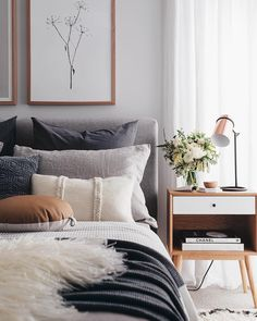 Grey bed like ours. Nice layers of color with metallic bedside lamp.