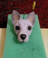 """Stages of felt dogs"""