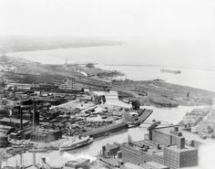 1920 photo shows the commercial development along the Cuyahoga River in Cleveland. This river would later become synonymous with environmental pollution, but the practice of dumping industrial waste into rivers was common throughout the nation at this time.