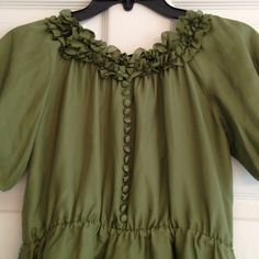 Deep green 100% pure silk top Beautiful green silk top with wonderful ruffled neckline and silk covered buttons down the front.. Sleeves are elasticized puffs.. Pre-loved in EUC.. Tops