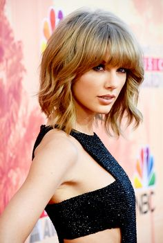 Taylor Swift with a lob and bangs