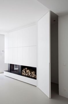white and black home with fireplace via ik ga bouwen — explore our parcels of elevated essentials for minimalist design enthusiasts @ minimalism.co