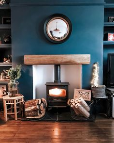 Farrow and Ball Stiffkey Blue wall, log burner. Living room inspo Farrow and Ball Log Burner Living Room, Living Room With Fireplace, My Living Room, Log Burner Fireplace, Blue Feature Wall Living Room, Brown And Blue Living Room, Wood Burner, Living Room Heater, Blue Living Room Walls