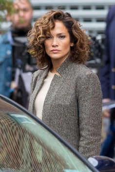 Actors Jennifer Lopez and Antonio Jaramillo are spotted on the set of 'Shades of Blue' in Sunset Park, NYC on November 2015 - Hair Cutting Style Medium Hair Styles, Curly Hair Styles, Short Layered Haircuts, Medium Length Curly Hairstyles, Medium Curly Bob, Layered Curly Hair, Curly Short, Short Bangs, Short Cuts