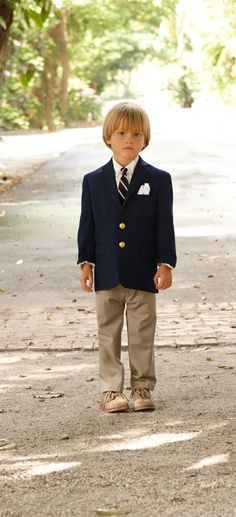 At summer weddings, little boys become little men dressed in suits that are all grown-up.