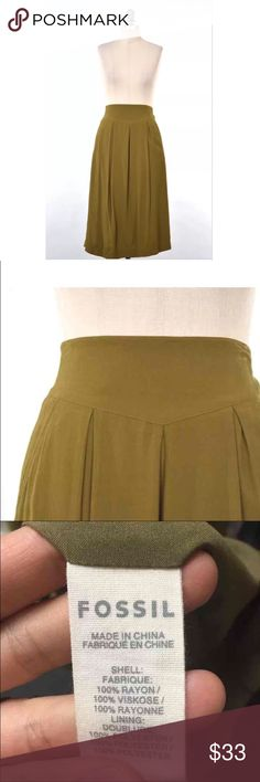 """Fossil silky olive green midi skirt Slinky, easy to wear summer midi skirt from Fossil. Muted moss green color. Wide waistband which is smocked at the back for a close fit. Pockets at the front hips. Midi length. Draped, silky rayon fabric; unlined. Size XS, can also fit a S, just pulls on - no closure. Length from waist : 28"""" Waist: 27"""" Fossil Skirts Midi"""