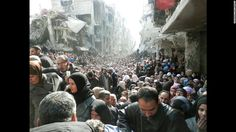 January 31/2014: Refugees at the besieged al-Yarmouk camp, south of Damascus, Syria, wait to receive food distributed by the U.N. Relief and Works Agency. Millions of people have either fled Syria or become displaced because of the civil war there.