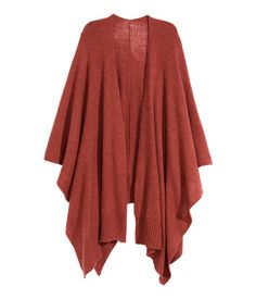 Soft rib-knit poncho in rust red wool blend.   Warm in H&M