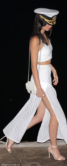 Ahoy captain Kendall Khardashian: The 19-year-old model rocked a crop top along with a vertical striped sheer ...