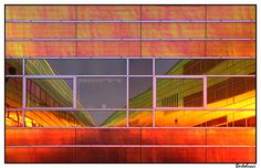 UNStudio's La Defense in Almere. A delightfully glass facaded 'chameleon' office building which loves the light .......and light always reciprokes, changing the way the multicoloured facades look and covering the different courtyards / patios of the building with an ever changing coloured tapestry. Why is this? The glass panels are bonded with rerflective 3M 'Luminous' foile which changes color with the angle of the sun.