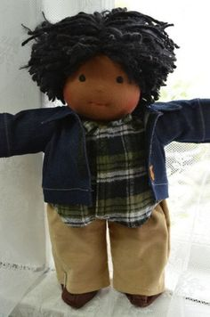 This is Cooper, a Classic Bamboletta boy from the Friday, June 28, 2013 upload.  He has dark skin, hair made with mohair and wool yarns in a black color with black nubby bits, black dreadlocks and dark brown eyes.  He is wearing the pictured outfit, underpants and wool felt shoes.