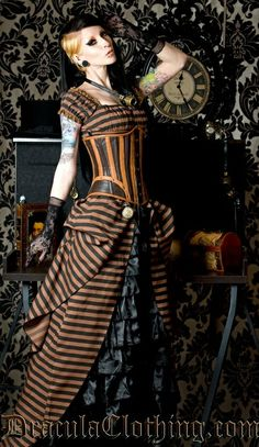 One of my favorites, steampunk, unique, dress with corset. i love the stripes and tailored corset it looks vintage yet futuristic. Black, rust- orange Halloween colored striped steampunk dress by katee