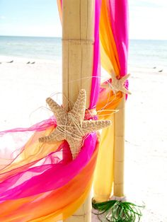 starfish tie-backs...one of my favorite additons to my beach wedding decor