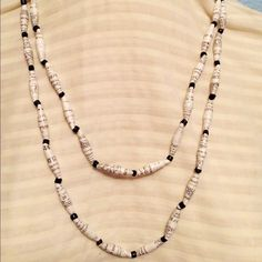 Black & white recycle paper bead necklace Black and white recycle paper bead double stand necklace with glass bead accents. New without tags. On stretchy string to fit most.  Please contact me if you have questions. Handmade Jewelry Necklaces