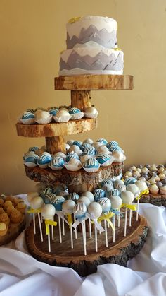 Cake Pops and a Mountain Scene tiered cutting cake by Pink Zebra Cupcakes in Denver CO. The wedding was held at Arapahoe Basin Ski Area's, Black Mountain Lodge