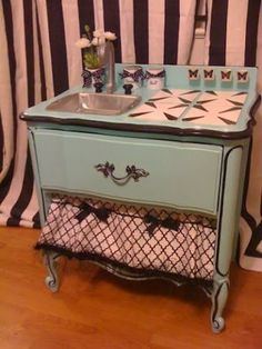 make a kid's sink from an old nightstand.  Attach a cookie sheet on the side for a magnet noteboard.