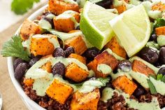 Hearty quinoa topped with roasted sweet potatoes and black beans, then finished with a cilantro cream drizzle.