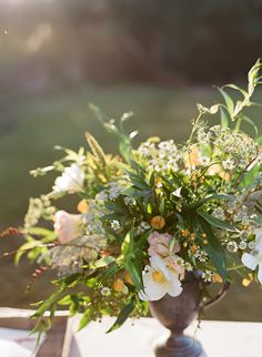 Casual floral arrangements. (Photo Credit: Marni Rothschild) #SouthernWeddings