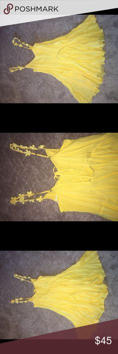 Yellow Sun Dress (Urban Outfitters) WORN ONCE I wore this beautiful dress to my high school graduation, beautiful bright yellow color, flowers on straps, open back with tie. ONLY WORN ONCE. (Urban Outfitters) (100% Rayon) hand wash cold Kimchi Blue Dresses Mini