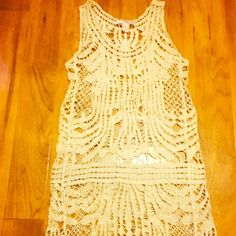 Metallic swimsuit cover up Cream colored with gold metallics woven thru out mesh type Forever 21 swimsuit cover up shows any swimsuit off beautifully Forever 21 Swim Coverups