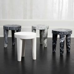 KELLY WEARSTLER | LARGE TRIBUTE STOOL. Hand-sculpted marble stools.