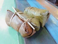 Kaotommad, sticky rice fried with coconut milk, added banana and black beans inside. Wrapped in coconut leaf and steamed. yum yum ♡