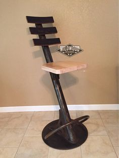 High back tall barstool. Made from heavy duty steel, maple or oak seat, and wine barrel staves. Seat is 31 tall, overall 43 tall. Many variations of patina finish color available.