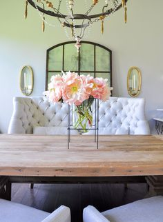Elegant dining room with tufted settee