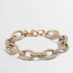 """J. Crew Factory gold and crystal link bracelet J. Crew Factory gold and crystal link bracelet. Zinc casting, glass stones, cubic zirconia. Worn gold plating. Length: 7 1/2"""". New with tags, unused. J. Crew Jewelry Bracelets"""